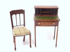 Dennis Jenvey Lady's Desk and Chair. From the Singing Tree, a delicate mahogany regency desk with inlaid leather writing surface and spade feet with a charming matching chair. D...
