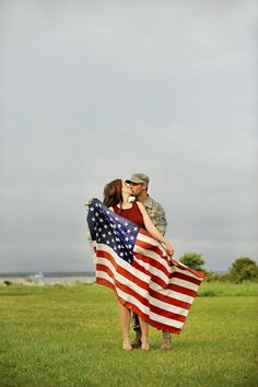 LOVE the American flag draped across the bride and groom! See more from this patriotic military wedding engagement session in Charleston, SC, by Follow Your Vision Photography! | The Pink Bride www.thepinkbride.com
