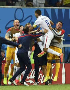 Moment #5 - Clint Dempsey scores for 2-1 lead Clint Dempsey of the U.S. (2nd R) celebrates after scoring a goal with teammates during their 2014 World Cup G soccer match against Portugal at the Amazonia arena in Manaus June 22, 2014. (REUTERS/Dylan Martinez)