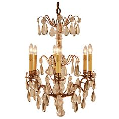 1930's French Crystal Chandelier | From a unique collection of antique and modern chandeliers and pendants  at https://www.1stdibs.com/furniture/lighting/chandeliers-pendant-lights/