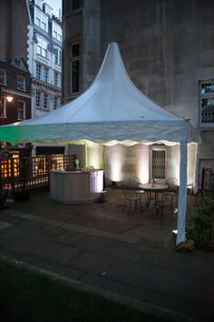 Reception tent for bar service in St James Garden. Summer outdoor Venue Hire through 195 Piccadilly, London