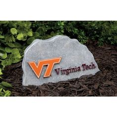 """Virginia Tech Hokies VT NCAA Tiding Stone Key Hider by Team Sports America. $22.99. 1 lb.. Maroon and Orange. Perfect for yourself or as a gift!. 3.5""""L x 9.2""""W x 5""""H. 3.5""""L x 9.2""""W x 5""""H Even the rocks in your yard should show off your team pride! This accent is subtle and sturdy cheering for the team while hiding your spare key. Fierce and strong school spirit deserves a place in your outdoor Decor. Save 15%!"""