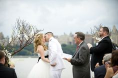 Jillian and Lee The New York City skyline provided a picture-perfect backdrop for this couple's ceremony on the Hudson River waterfront. Lee's Coast Guard buddies created a saber arch for the couple to walk under before they all headed over to the Waterside Restaurant to celebrate. The couple's cake topper featured a man in uniform, and Jillian did the honors of cutting the cake using Lee's sword. Photography by De Nueva Photography. Coast Guard Wedding, Us Coast Guard, Military Weddings, Military Couples, Coast Guard Girlfriend, Wedding Engagement, Engagement Ideas, Men In Uniform, Sword Photography