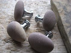 Stone cabinet knobs. Would be awesome to figure out how to make this a DIY project.