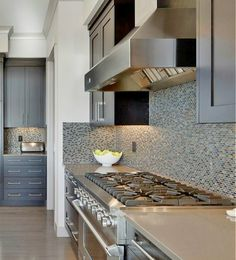 Future kitchen! A kitchen that inspires us to cook. Beautiful kitchen with dark cabinet, central island, mosaic backsplash and contemporary range hood.
