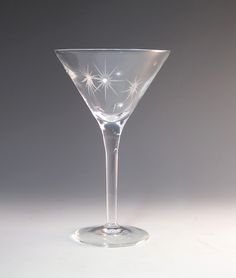 More sparkle for your day!  As if this blown crystal glass weren't already spectacular enough, these unique Martini glasses are etched  with beaming stars all around - plus one on the foot for extra glint - and embellished them with clear Swarovski crystals. A toast the to moon, the stars and your favorite couple!