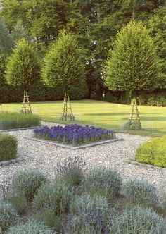 Again with square beds set in gravel and informal, abundant plants, here shown next to a lawn (Landscape Design by Miranda Brooks)