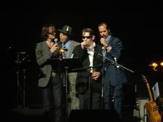 """Nick Cave, Shane McGowan, Pete Doherty and Jarvis Cocker, singing """"Home Sweet Home"""" from the Lady and the Tramp soundtrack. There's about 10lbs of WTF in a 5lbs bag going on in this photo."""
