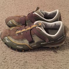 Army/brown Skechers Skechers tennis shoes. They are army color with brown and gold/dark yellow trim. Great condition and very comfortable! Skechers Shoes Sneakers