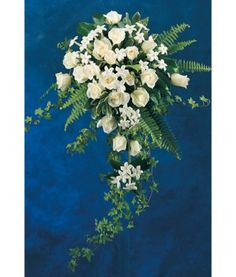 stephanotis, roses, fern and trailing ivy cascade bouquet