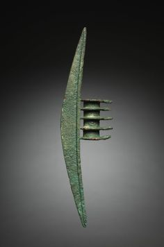 Halberd, c. 1000 BC (Iran, Amlash, 11th century BC) A Halberd is a combination of spear and battle-ax. This one is 13 inches long. http://www.clevelandart.org/art/1966.519?f[0]=field_collection%3A825