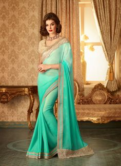 Look stellar with this sea green shaded saree elegantly crafted with resham and zari work. It is paired with matching embroidered blouse material.The blouse can be stitched upto size 42. be stitched upto size 42. For stitching enquiries, please email us at customercare@hunardesigns.com  |…
