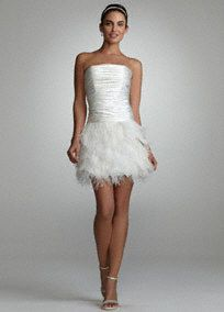Elegant and fun, be the picture of perfection as you walk down the aisle!  Strapless ruched charmeuse dropped waist bodice is absolutely stunning.  Tiered feather organza skirt adds tons of drama to this already beautiful dress.  Available in sizes 2-14. Available in Softwhite.  Fully lined. Back zip. Imported. Dry clean.