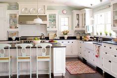 like the stools and black marble countertops