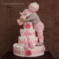 Pink color elephant and baby girl theme diaper cake for newborn and infant girls. Local delivery offered in Toronto and GTA.