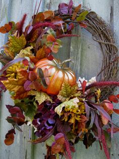 Love the colors in this wreath. Autumn Fall Woodland Pumpkin Wreath by NewEnglandWreath on Etsy