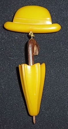 A fun vintage Bakelite hat and umbrella dangle brooch. #vintage #jewelry #brooches