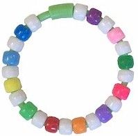 Girl Scout Law Bracelet from MakingFriends.com  Add the colored beads with each part of the Girl Scout Law you earn with your Daisys.