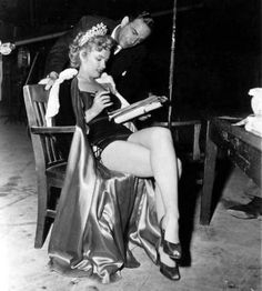 Marilyn and dialogue director Tony Jowitt on the set of ''We're Not Married'', 1952.