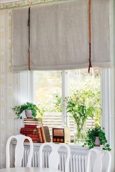 Here is a great little DIY window treatment project. Raw linen fabric (rough edges) on a simple rod with leather belts as fabric holders.