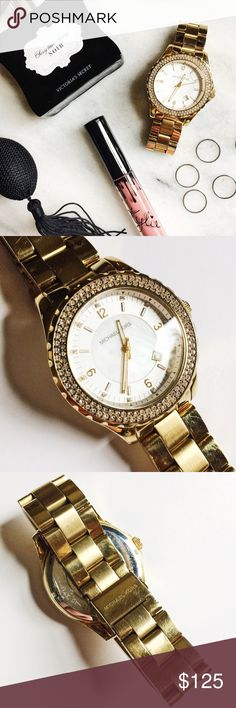 Michael Kors Madison Boyfriend Watch Michael Kors Madison Boyfriend Watch in stainless steel featuring a gold tone finish.  Swarovski crystals and Mother of Pearl face.  Pre-loved but in excellent condition.  Minor scratches on band from everyday wear.  No damage or missing stones on face.  33mm dial.  Authentic, no trades. Michael Kors Accessories Watches