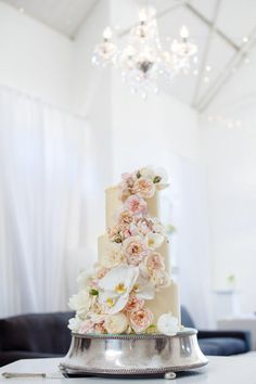 Cascading floral decoration on wedding cake with Garden roses & Phaleonopsis orchids