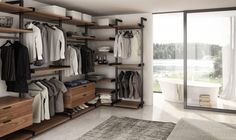 A guide to style & life from the premier home decor store in Richmond, VA. Introducing the Gravity Wall System to conquer the clutter. Joel Dupras at Huppe in Bedroom Closet Design, Closet Designs, Bedroom Decor, Bedroom Furniture, Garderobe Design, Dressing Design, Wardrobe Systems, Wardrobe Room, Open Wardrobe