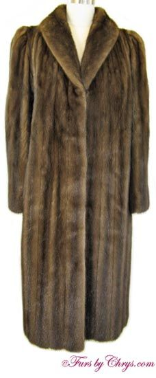 Mahogany Mink Coat #MM757; $1200.00; Excellent Condition; Size range: 6 - 10. This is a gorgeous genuine natural mahogany mink fur coat which looks as if it was rarely, if ever, worn. It has Furs by Michael Valente label and features a shawl collar and straight sleeves.  This is an absolutely high-quality mink coat; the mink fur is very silky soft and extra shiny.  If you would like to wear pure luxury but not spend a fortune, this is the mink coat for you!
