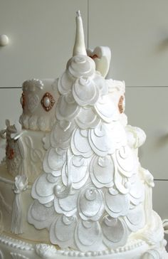 I have just found Leslie Guyton's wedding cake! Except she would want it in colors not all white...