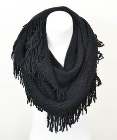 Feeling comfy and cozy couldn't get any easier with this finely-knitted infinity scarf, adorned with pretty fringes to add to its charm.22'' W x 26''100% acrylicHand washImported