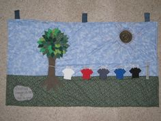 Tree with Clothesline Quilt.  Clothing made from cut up shirts.