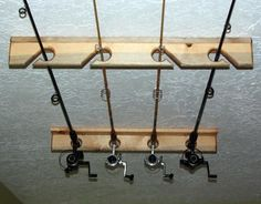 Fishing rod holder, expand to hold more rods and mount to garage ceiling.