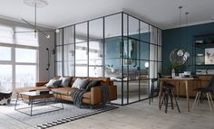 A modern, compact apartment in the center of Kiev was designed by MARTIN architects to be light and airy with the help of a bedroom enclosed in glass.