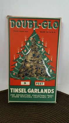 """Vintage - ORIGINAL box of DOUBL-GLO Tinsel Garlands - 9 ft with """"shimmery"""" silver and blue colors."""