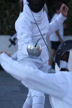 Fencing look at the reflection on the bell – FENCE Fencing Lessons, Olympic Fencing, Fencing Sport, Sword Fight, Pose Reference, Stunts, Fence, Modern Design, Swords