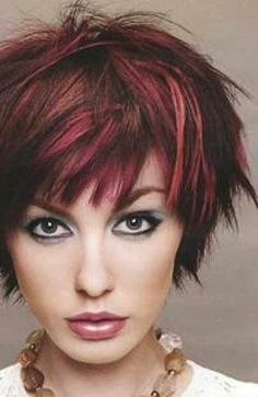 Short messy hair with spiky pieces, dark red.
