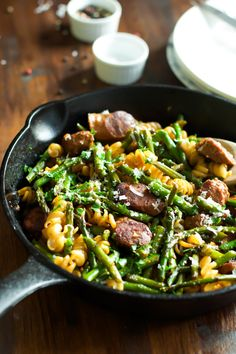 Quinoa pasta with sausage and asparagus.  Switch to chicken or turkey sausage to lighten up even more!