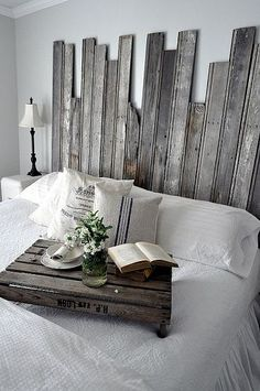 Reclaimed Wooden Headboard. Not sure he would go for this, but he may not have a choice! Beautiful...