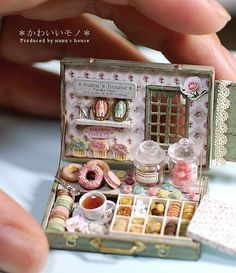 minature cake shop - I wonder if you could make this in a normal sized suitcase with felt cakes and cute wallpaper oooo the possibilities!!!!!