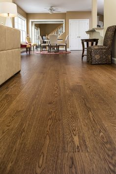 Wide plank white oak, finished with medium brown stain and high resin tung oil. This versatile wood is perfect with any design style and in any room in your home.