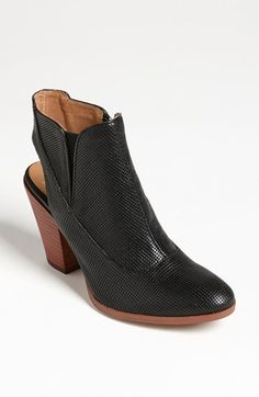 I love the modern yet warm  feel of these back cutout booties.  I'd wear them with rolled up grey denim pants, a slouchy black tee and a leather jacket.