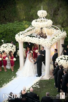 Beautiful Ceremony Structures | InsideWeddings.com  Over 100 colors of eco-friendly rose petals are available at Flyboy Naturals Rose Petals.  NON-STAINING!  www.flyboynaturals.com