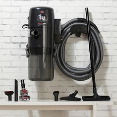 Cleaning just got a lot easier with this amazing wet/dry vacuum! Garage Vacuums, Vacum Cleaner, Wet Dry Vacuum Cleaner, Hose Holder, Best Vacuum, Garage Makeover, Hanging Racks, Floor Care, Tidy Up