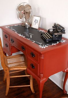 The desk is what makes the workspace -- Another application of Chalkboard paint...and a vintage typewriter to boot. Score!