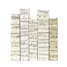 Sheet Music covered books, for matching bookcase display...you could even do this on a removable cover so you're not destroying the book...gives me lots of ideas!