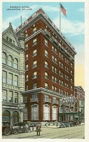 Phoenix Hotel, E. Main St., Lexington, KY, was established in the 1820s & became a prominent landmark as well as the oldest hostelry by succession in the area. The site that would become the Phoenix originally housed Postlethwaite's Tavern, which was constructed in 1800. Several name changes occurred between 1800 and 1820, one of which was to Wilson's Tavern, which was visited by Col. Aaron Burr in 1806. After several reincarnations, the building was demolished in 1987 & replaced by Phoenix…