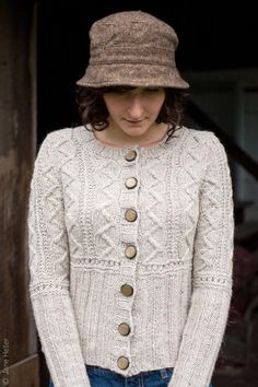Hallett's Ledge by Elinor Brown ~ love the pattern but think I would add a little ease into the sides and perhaps a bit of a flair toward the bottom.  Never like to see buttons pulled on a wearer.....  Bottom-up knit in Aran 10ply