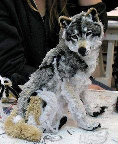 Artist design of a wolf made from pipe cleaners. What medium can you envisage for an art project?