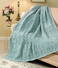 Post-Stitch Crochet Afghan~ Textured blocks featuring a variety of post-stitch patterns are creatively combined for a dramatic study in dimensional design in this afghan work of art. Lustrous pearl beads add shimmering highlights to alternating squares.