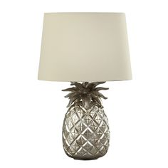 Add a touch of tropical to your interiors with the Pineapple Champagne Table Lamp.